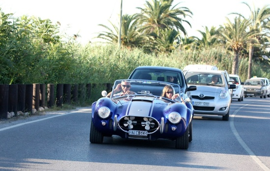 Christian Audigier and girlfriend Nathalie Sorensen drive around Ibiza in a vintage AC Cobra.#Repin By:Pinterest++ for iPad#