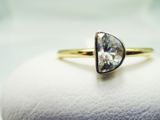 For a cosmic love. Half Moon Diamond Engagement Ring 14k by TheEyeofTheMoonJewel. $1,100.00, via Etsy.
