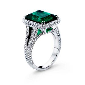 Platinum colombian emerald and pave diamond ring