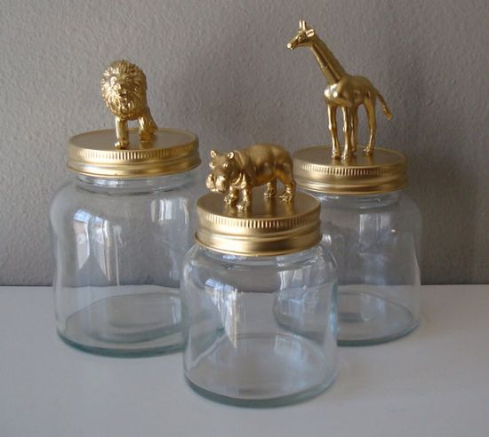 home decor - storage jars: gold, lion, giraffe, hippo glue plastic animals onto the lid and paint!