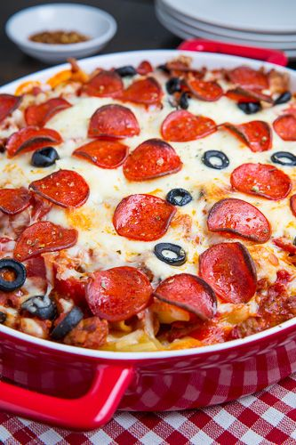 Pepperoni Pizza Casserole--->sounds easy and family friendlyIngredients  12 ounces pasta  1/2 pound Italian turkey sausage, casings removed  3 cups (24 ounces) pizza sauce or marinara sauce  1/2 cup sliced black olives  4 ounces pepperoni  8 ounces ricotta  2 cups mozzarella, shredded  1/2 cup parmigiano reggiano (parmesan), grated  1/2 teaspoon oregano (optional)