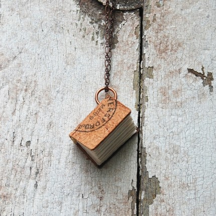 """Royersford 1906 Leather Postcard Journal Necklace: A wonderful wearable and useable mini book. Size: 1 1/4""""high, 1"""" wide, 1/2' spine, 42 sheets on copper loop with 16"""" copper chain."""