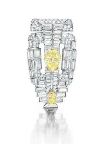 AN ART DECO DIAMOND AND COLORED DIAMOND BROOCH