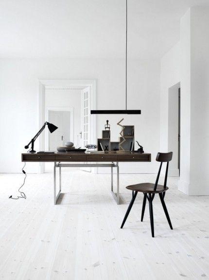 A minimalist white space. Beautiful wood desk