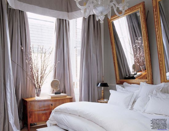 love the angled mirrors as a headboard!