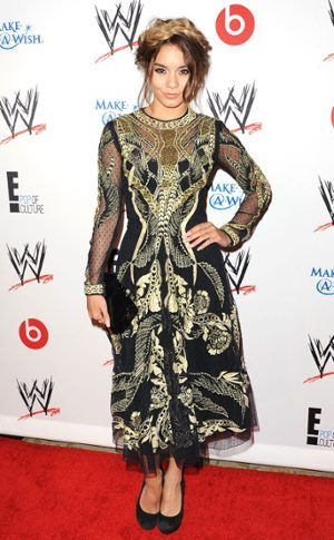 Vanessa Hudgens goes for the gold (and black) in Temperly London. #fashion