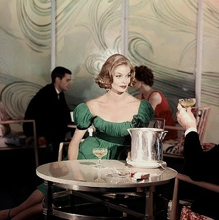 """Cheers"", he said, ""for being so incredibly sophisticated looking it puts this champagne to shame."" #vintage #1950s #fashion #green #dress"