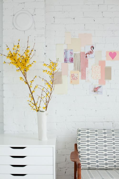 love the pop of yellow and the brick wall in the background painted white!