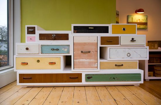 "furniture piece constructed from ""orphaned drawers."""