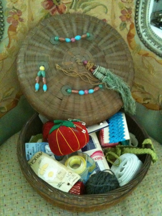 an asian sewing basket filled with vintage notions & goodies