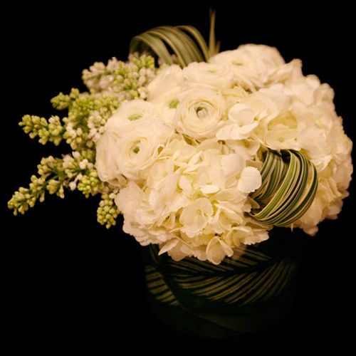 Corporate flowers,  corporate flower centerpiece,  add pic source on comment and we will update it. www.myfloweraffai... can create this beautiful flower look.