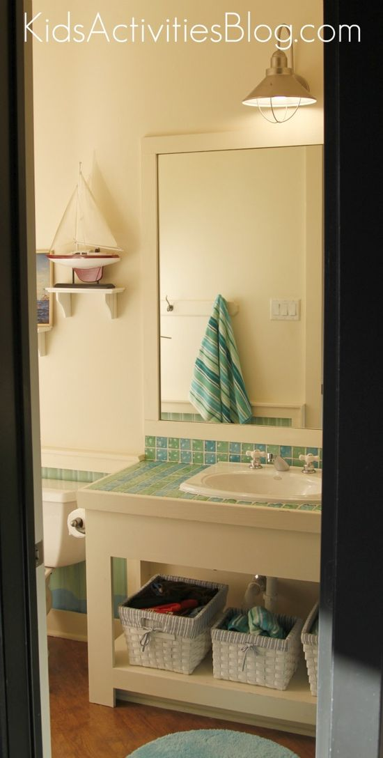 A kid-friendly bathroom remodel using roofing materials as a splash guard!  A must have if you have boys.