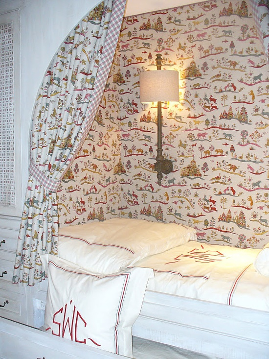 Cozy nook for sleeping. Love the wallpaper and curtain.