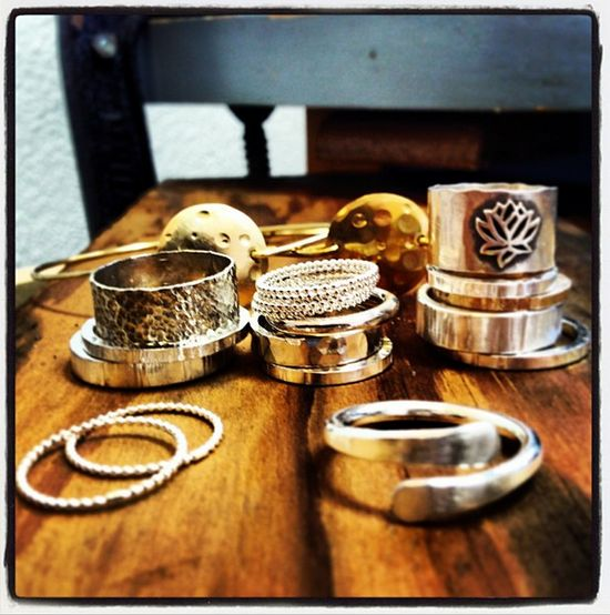 An amazing array of rings and bracelets by Praxis Jewelry!