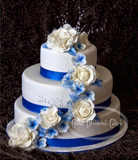 Royal Blue and White wedding cake ~ handmade roses and blue Frangipannis (Plumeria) ~ All edible