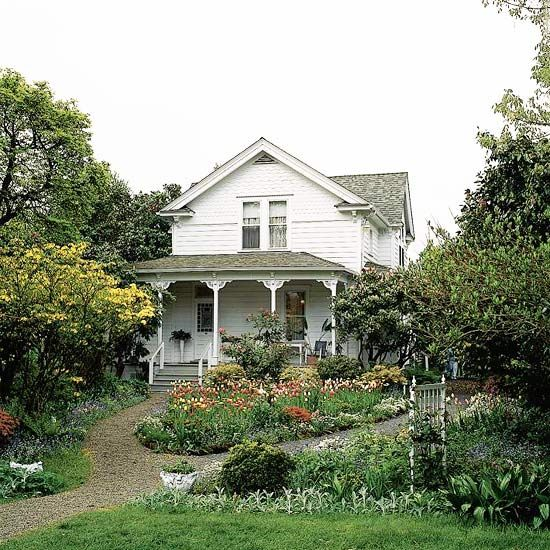 Old farmhouse and flower beds
