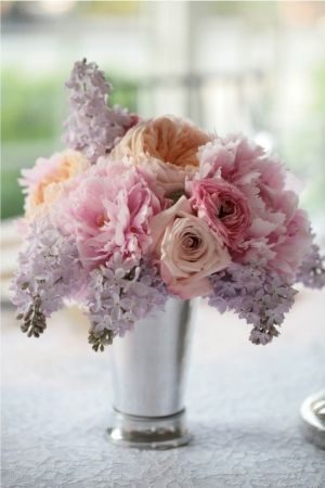 Table Arrangement in shades of pastel purple, peaches and pinks by mandy
