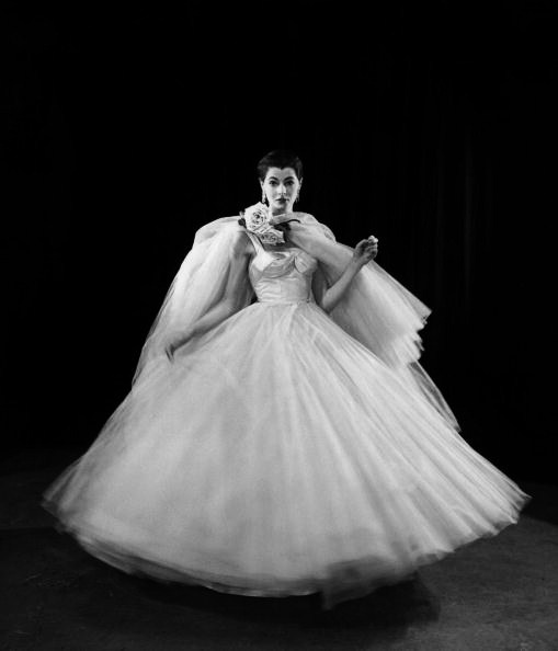 Sydney Stamp, modelling Hardy's dream dress of layered white tulle and draped satin. #vintage #fashion #dress #1950s