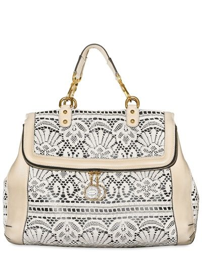 Aaahhh Lace and a handbag all in one. I need this. Dolce and Gabbana are very smart men