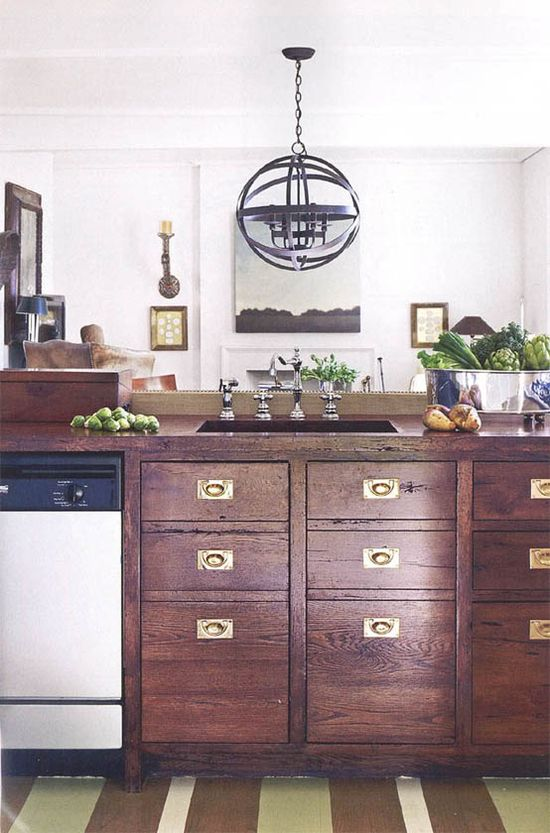 Wood cabinets with brass hardware.