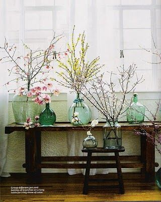 Old glass bottles with flowering branches, love!