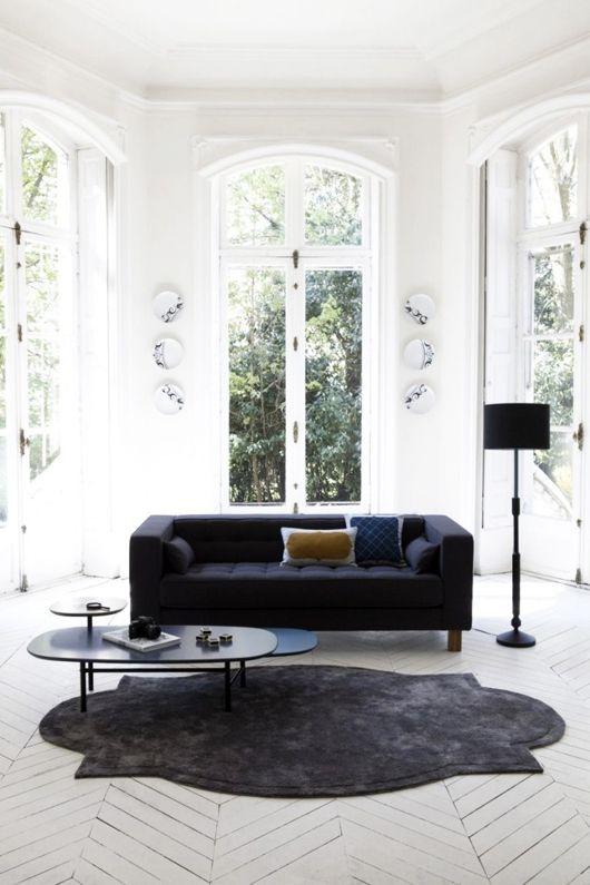 black-sofa-in-white-room