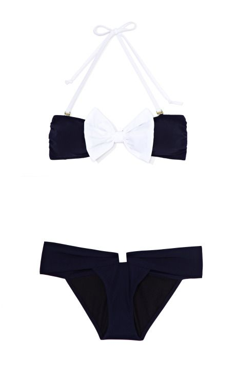 a white and navy swimsuit that is too cute for words.