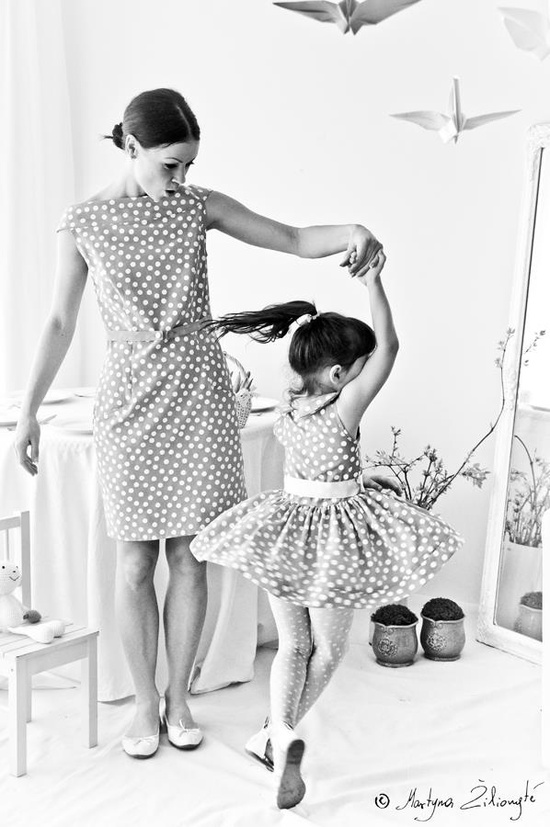 this is so cute!!! i love the mother/ daughter and polka a dot thing :) and the twirling is adorable. really cute picture!