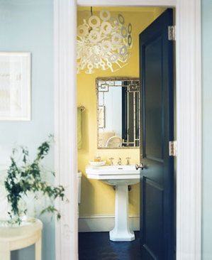I love everything I see.  I can see me having a dark blue door & bathroom floor with that yellow on the walls and the light blue on bedroom wall with those white fitures.  Big LIKE!