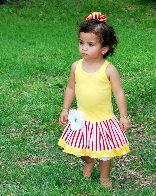 For BRYLEE  Outfit inspiration... looks like a pretty piece of carnival popcorn!