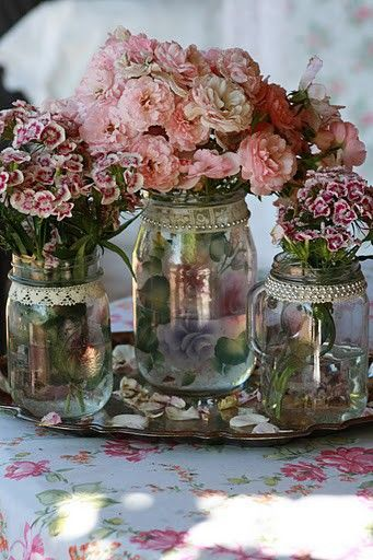 Lace and pearls around jar mouths, to use as vases. So pretty.