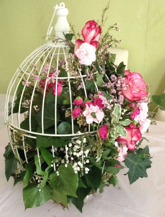 Flower arrangement in birdcage