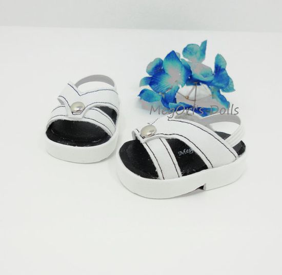 "White ""Vivid"" sandals designed by me for your 18"" American Girl dolls! They are made of white suede vinyl craft foam. Each sandal has an elastic strap in the back to keep on the doll securely. Sandals are decorated with top stitches and mini metal studs. american girl 18 doll sandals white VIVID in by MegOrisDolls, $13.00"