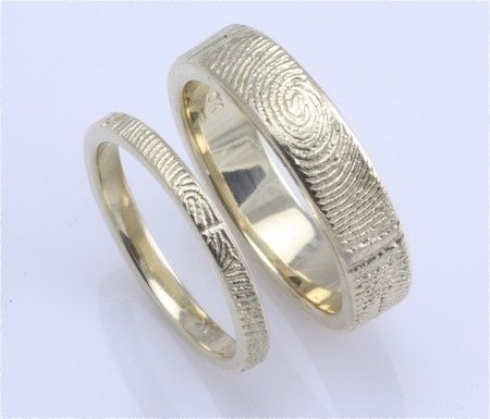 his and her wedding bands with the others fingerprint.