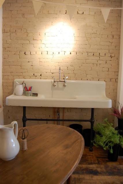 vintage sink + white brick + iron base