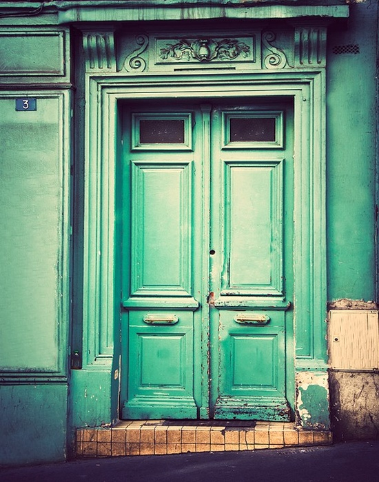 Photograph of an old, rustic door in Paris, France