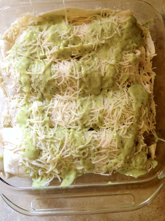 The cilantro avacado cream sauce is amazing! Cilantro Lime Chicken Enchiladas with Avocado cream sauce
