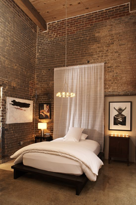 Great way to give a little warmth to exposed brick around the bed