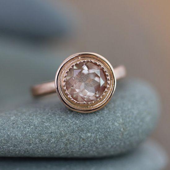 14k Rose Gold and Oregon Sunstone Halo Ring by onegarnetgirl. , via Etsy.