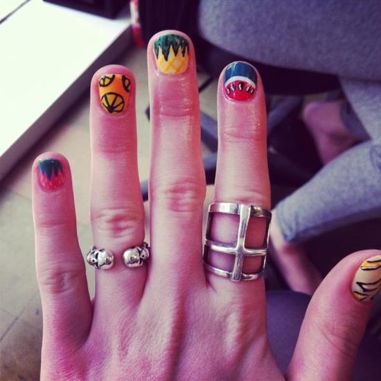 Creative nails and bold rings.