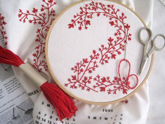 stitching.  tea towel calendar by curious doodles