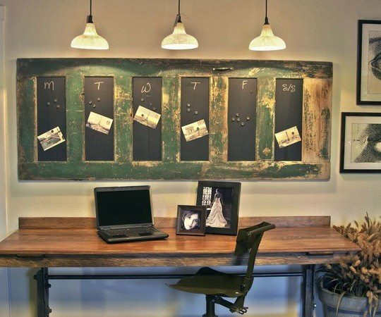 Repurposed door. Chalkboard the centers. Cute idea for kids craft/toy room as well as the office. Although for office, I'd go as far as a peg board, and magnetic board in the centers.