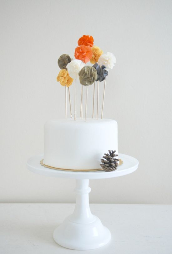 Pompom toppers add festive flair to this simple cake. #MarthaStewartWeddingsMagazine
