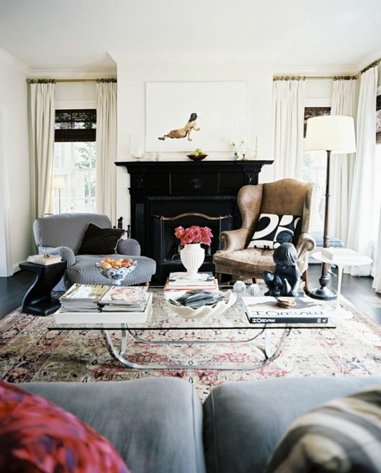 Layered living room with lots of textures, old rug, stripped chair, overall neutral with pops of pink!
