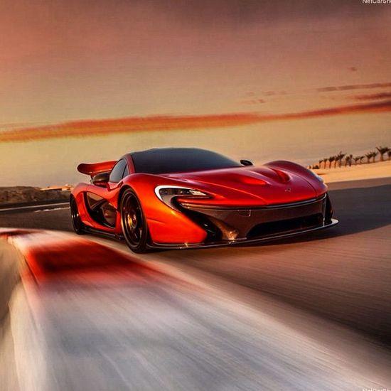 McLaren P1 racing at sunset