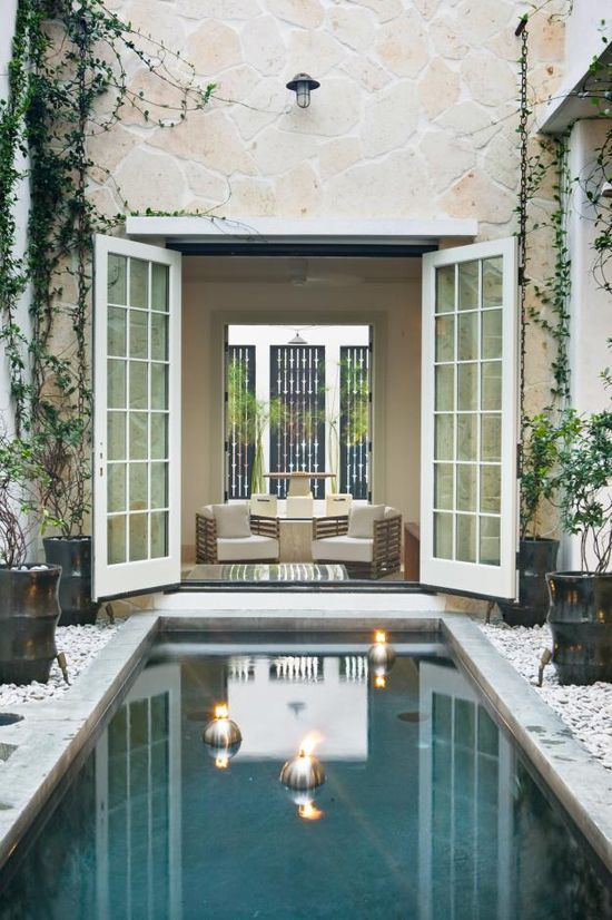 Courtyard pool by Troy Rhone Garden Design.  This might be a stretch, but if I had enough money, I would totally build a house around a courtyard.  This gives you a beautiful view no matter where in the house you are!
