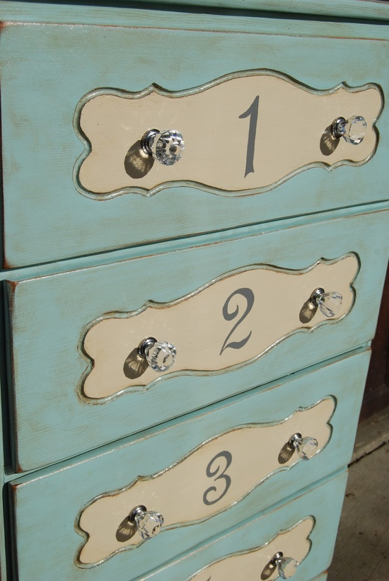 Love the colors, numbers, and glass knobs