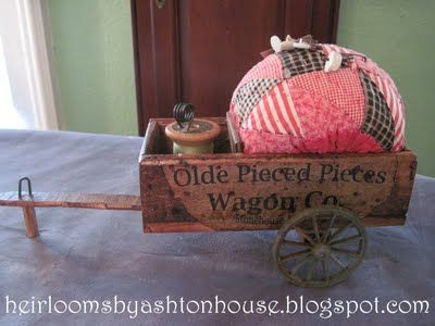 pin cushion in wagon... beautiful quilting site