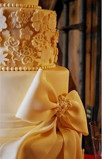 lace wedding cake with bow.