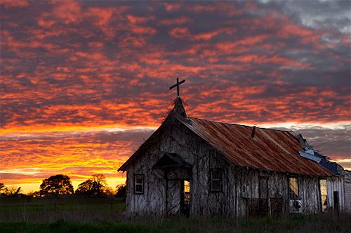 Abandoned Church with orange sunset in Central Texas.